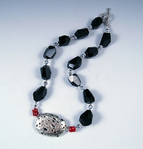 """Kissed"" Necklace in White Gold Leaf on Lava Stone, Black Tourmaline, and Sterling SilverJewelry, white gold leaf  lava stone necklace with natural black tourmaline and sterling silvce saucer beads and sterling toggle clasp"