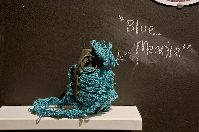 hand crocheted hand grenade cosy