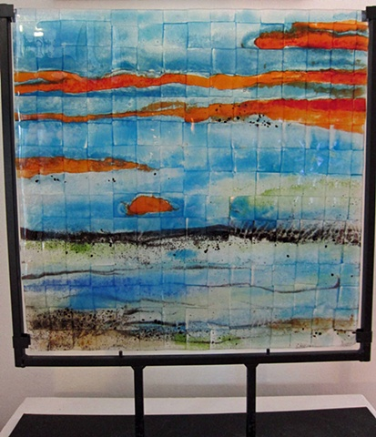 """Sanctuary Sunrise""... details: fused glass in sturdy black metal stand glass is 16"" wide x 19.25"" tall $550"
