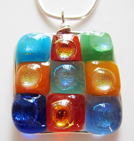 """Modern art for your neck...""  details: fused glass and silver wire wrapped 1"" square pendant comes on 18"" classic silver snake chain"