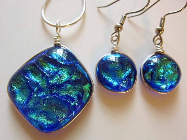 """Deep Ocean Blue"" Large Pillow necklace and earrings  details: pendant is approx. 1.25"" across and comes on 18"" silver snake chain--$60; earrings are approx. 1/2"" across and come on hypoallergenic ear wires--$38"