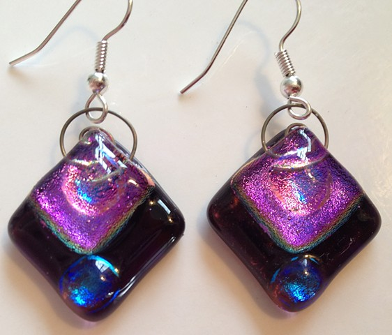 "Purple Diamond Delights!   Details: very purple glass with sparkly dichroic glass, with spiral wire tops, to hang from hypoallergenic ear wires; about 1"" x 1""""."