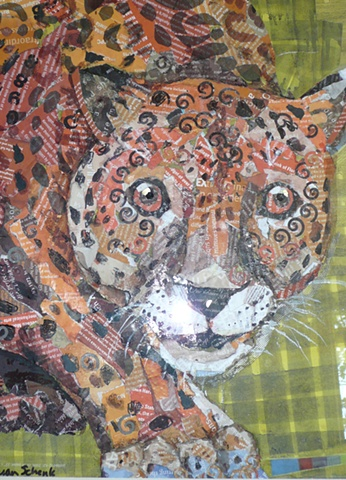 large spotted cat rendered as a collage