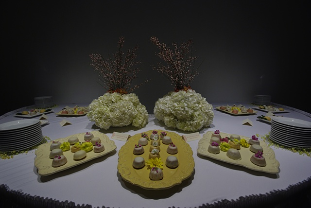 Breast Milk petit fours and lactating flower arrangements.