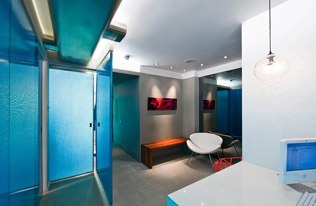 E. 40th St. Dental Office, modern dental office,  reception area, walnut door, by Doug Stiles Interior Design