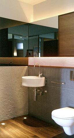 Washington Square Loft, modern minimalist bathroom, stone source, Basalt stone, grey mirror, ceramica flaminia sink, by Doug Stiles Interior Design