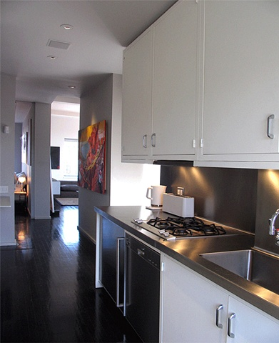 prewar penthouse apartment, modern minimalist livingroom, metal cabinets, by Doug Stiles Interior Design
