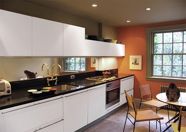 West Village Townhouse, modern kitchen, valcucine cabinetry, paul McCobb shovel chair, orange wall, by Doug Stiles Interior Design