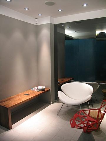 E. 40th St. Dental Office, modern dental office,  reception area, paulin orange slice, by Doug Stiles Interior Design chair, grcic chair one, custom walnut bench