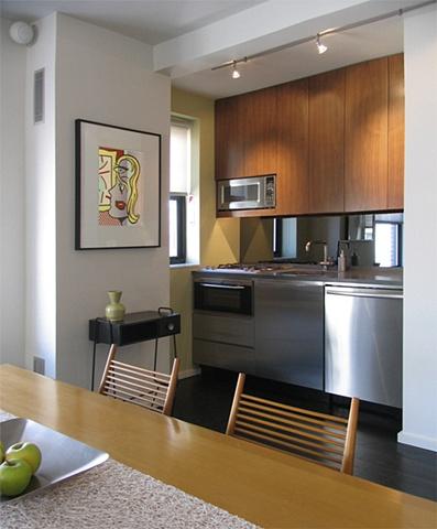prewar penthouse apartment, modern minimalist kitchen, Lichtenstein print, paul McCobb table and shovel chair, by Doug Stiles Interior Design