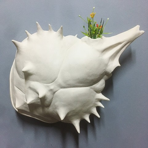 crab remnant, bone sculpture with artificial flowers by Bethany Krull