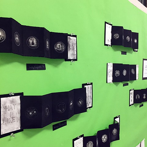 Installation of Miniature Charcoal Books in the style of Emily Holt Upper School Drawing