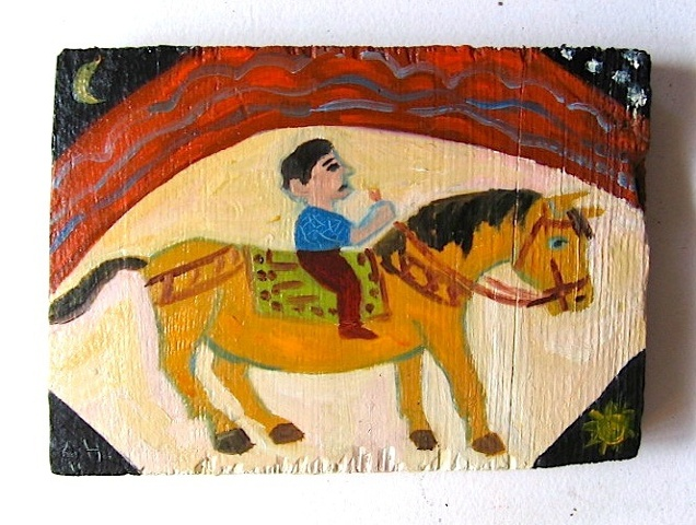 boy on yellow horse