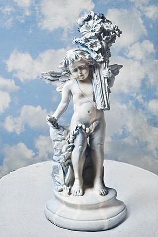 photograph of angel statue with clouds by christopher andres