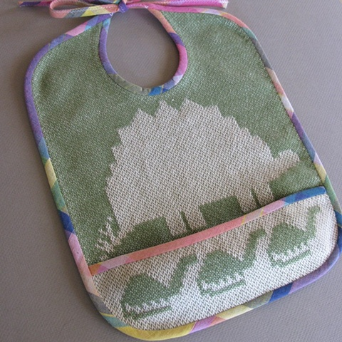handwoven cotton baby or toddler bib, drawloom weaving by Kathie Roig