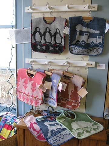 handweaving shop, gallery, baby bibs, cotton, animals, train, handwoven by Kathie Roig