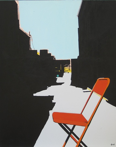 orange chair in alley