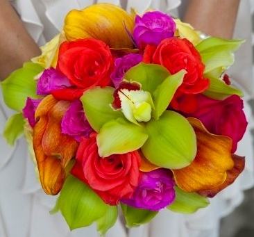 Colorful Bridesmaid Bouquet composed of mango calla lilies, yellow and pink roses, purple mini carnations, and green cymbidium orchids.  Tropical Bridesmaid Bouquets