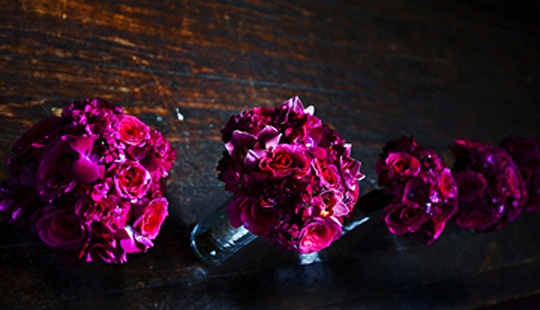Magenta Textured Bridesmaid Bouquets  Magenta, textured bouquets of roses, dahlias, sweet william, and cymbidium and dendrobium orchids.