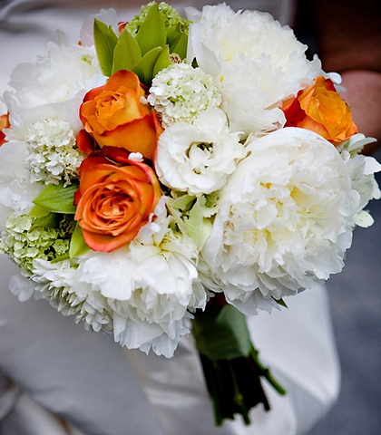 Colorful Peony Bridal Bouquet Stacey Bode Photography Colorful Bridal Bouquet composed of white peonies, dahlias, and lisianthus, green viburnum and cymbidium orchids, and orange-tipped bicolor roses hand-tied with a sage green satin ribbon.