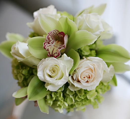 Bridesmaid Bouquet composed of green hydrangea, green cymbidium orchids, and white roses.  Green and White Bridesmaid Bouquet