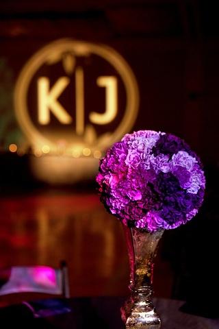 "Purple Carnation Pomander balanced on a 20"" Mercury Glass Candle Holder."