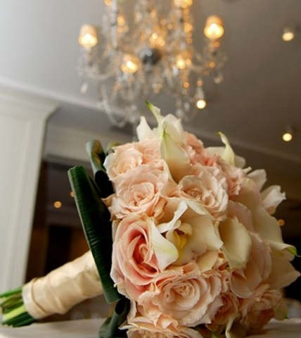 Daniel Menacher Photography Bridal Bouquet composed of light peach roses, white jewelled mini calla lilies, and white cymbidium orchids.