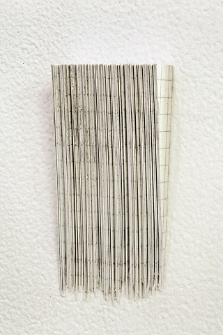 sculpture made with one hundred corners cut from one hundred invites to my show called hundreds of things volume 1