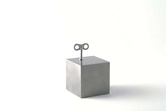 Small Box That Tics, Ken Nicol, K. Nicol, K-Nicol, Convceptual Artist, Toronto Artist, Obsessive, Compulsive, Order, Pattern, Theory, Stainless Steel, Sculpture, Object, clock, tick, winder, antique