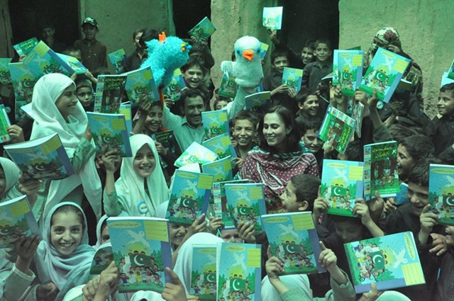 Distribution of Amai copies in Afghan refugee camp in Islamabad