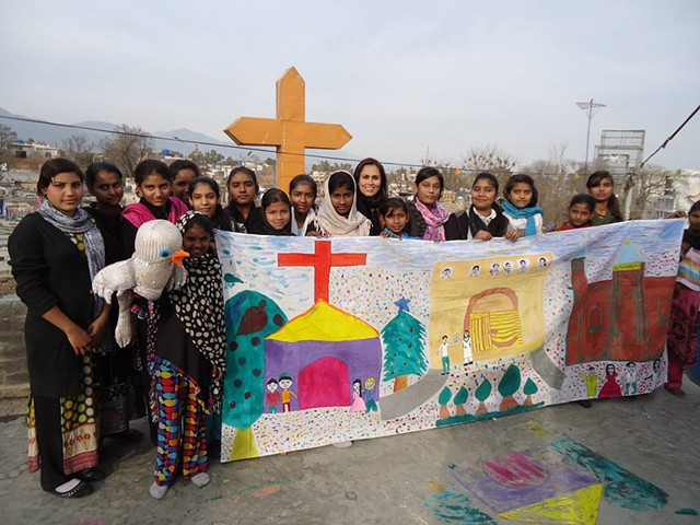 Mural 'Respect' painted by children in a shanty town of Islamabad