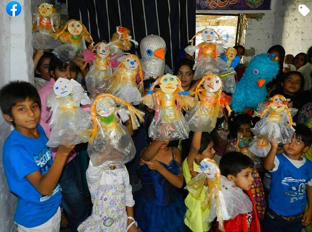 Creating art from trash-  dolls made from plastic bottles and polythene bags