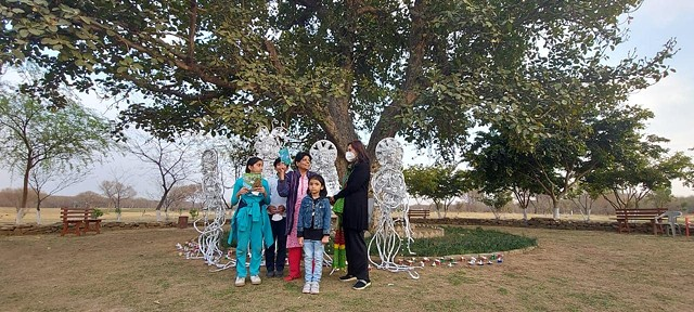 Installation'Tinfoil Mother Nature's Tribe'. Celebrated poet Kishwar Naheed was the guest of honour on the occasion of declaring an old banyan tree as a 'Natural Monument' by the Capital Development Authority.