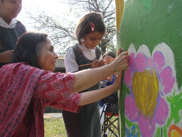 Painting murals at 'Amai Park' specially designed by Fauzia Minallah at the Almaktoom Center for the Visually Impaired in Islamabad.