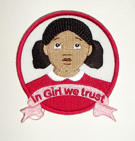 Badge featuring Girl's logo.  Can be sewn onto any fabric accessory or clothing.