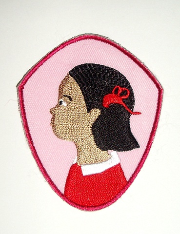 Badge featuring Girl's profile. Can be sewn onto any clothing or fabric accessory.