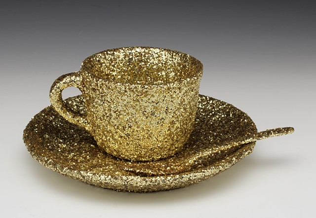 "Meret Oppenheim's ""Object"" reimagined by a homosexual, in gold"