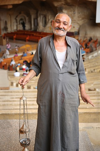 Man with incense burner in Coptic Cave Church