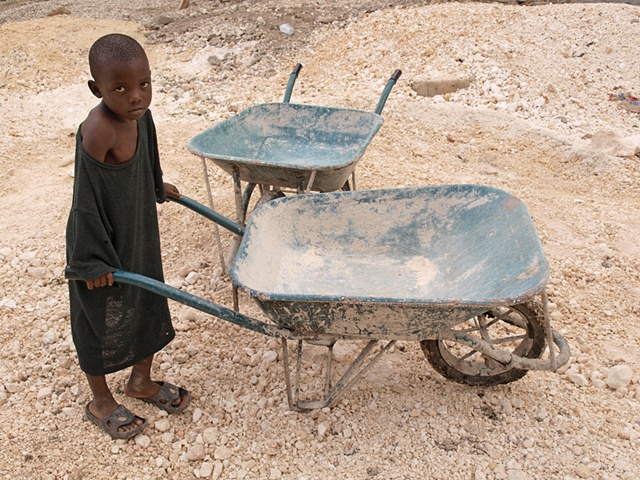 Boy with wheelbarrow