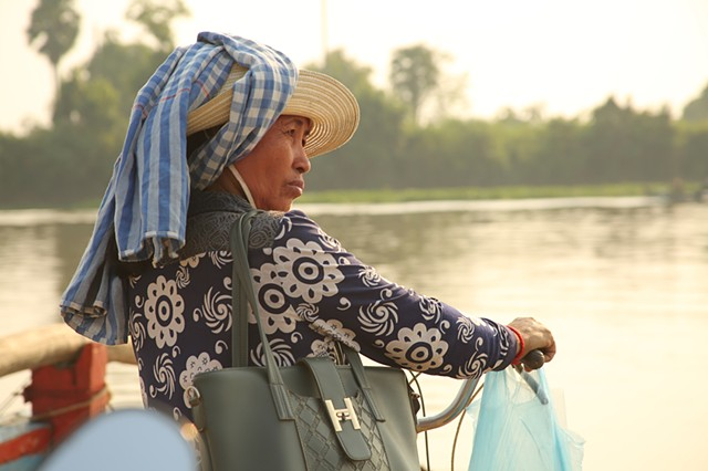 Passenger on Tonle Sap River ferry