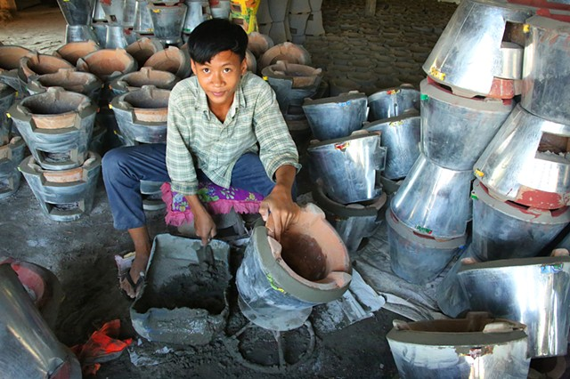 Boy working in family pottery business in the pottery village near the city of Kampong Chhnang