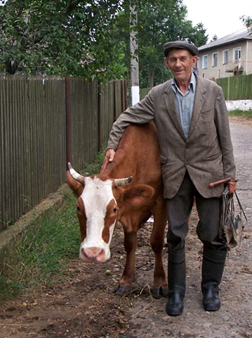 Mykola and his cow Kalyna