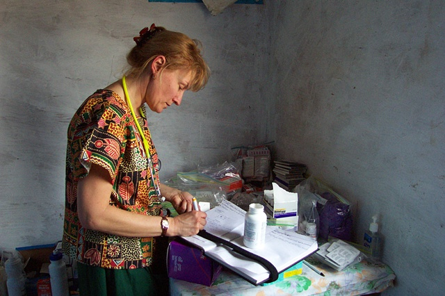 Missionary nurse making notes