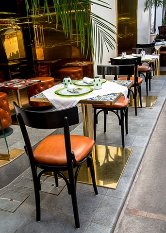 Tables angled along the sidewalk of this Capri Cafe