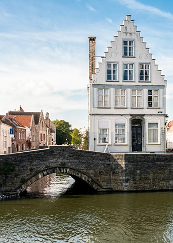 Canals and Bridges in Bruges are around every turn, colourful house line the routes