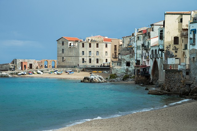 The old medieval Sicilian town of Cefalu, with the houses built right onto the beach.