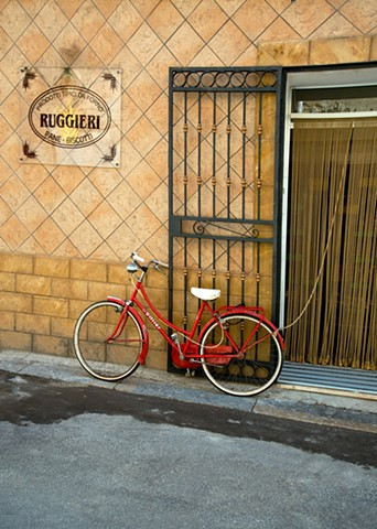 A Red Bike Parked outside the Ruggieri Bakery in Marsala, Sicily, Italy