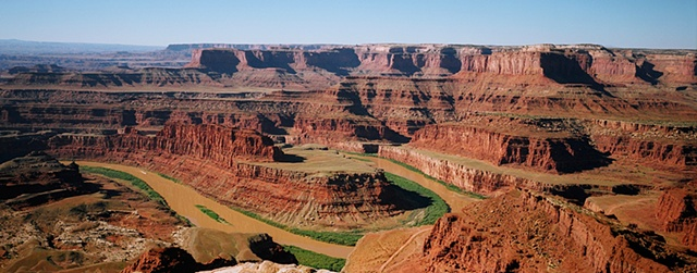 Panorama of river and canyon at Dead Horse Point State Park Utah, red rock and blue skies