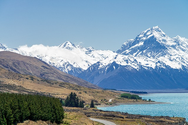 Snow capped mountains and a glacial lake on the way to Mount Cook