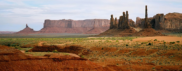 Panorama of Totem Pole rocks in Monument Valley Arizona, lush colors due to rainfall